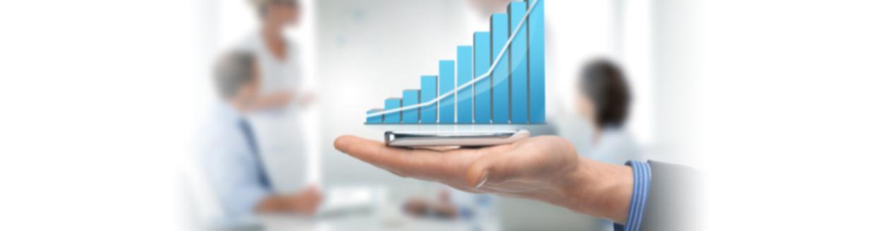 Open hand holding a rising bar graph